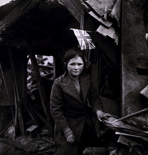 A girl standing in the ruins of Battersea in January, 1945, after a V2 raid. Photograph taken by Toni Frissell, US Women's Army Corps.
